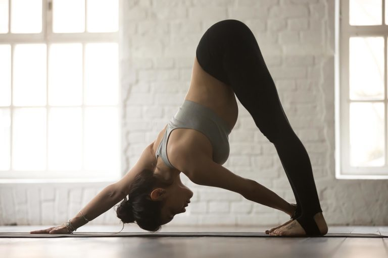 Woman performing pilates stretches