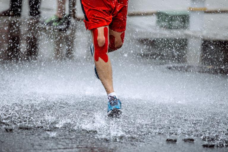 Runner on wet road
